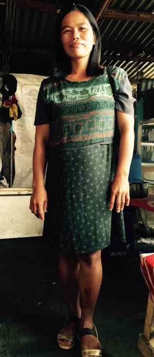 neda wears a dress