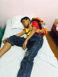 sleeping in his school bag