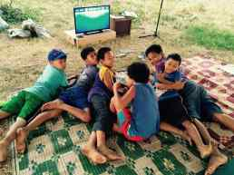 boys watching ocean documentary instead of playing computer games #earthday
