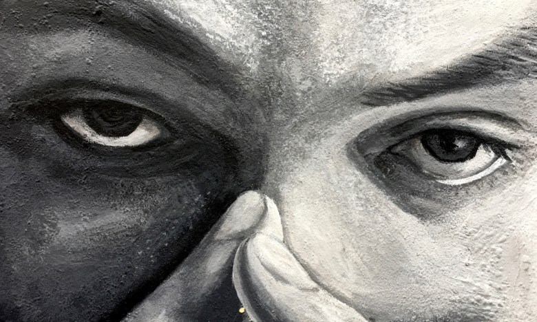 black and white mural (close up of eyes and fingernails)