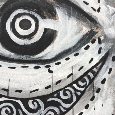 black and white abstract mural of an eye