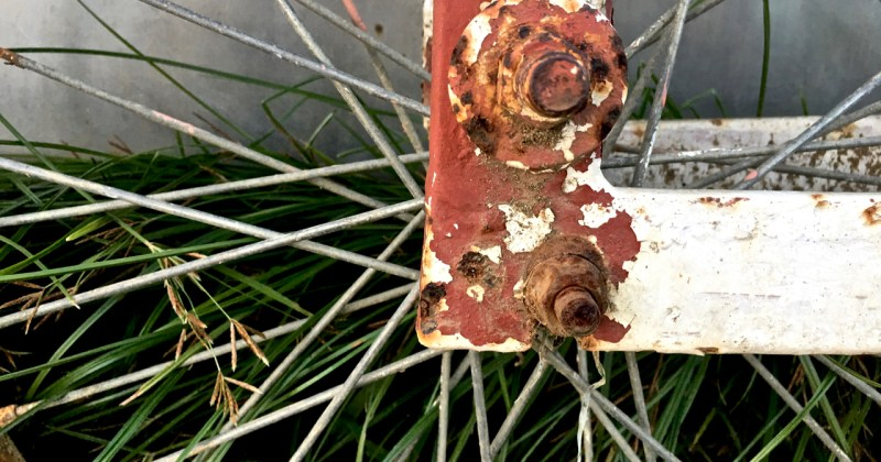 piece of a discarded bicycle wheel