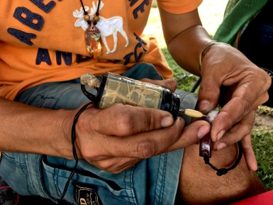 craftsman engraving a leather bracelet