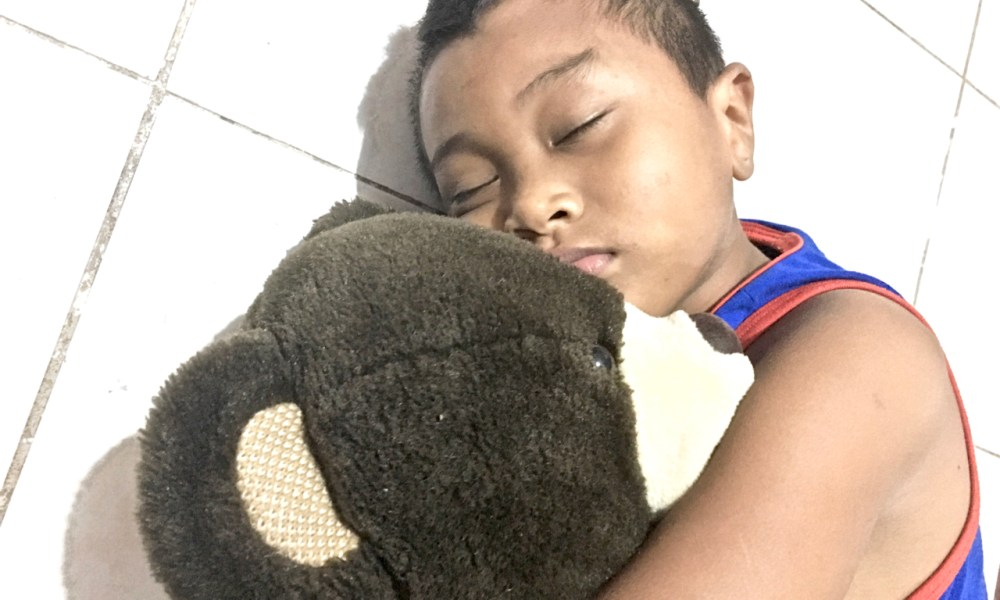 experimenting with high high portraiture this little boy and his teddy bear