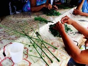 ladies prepare green vegetables