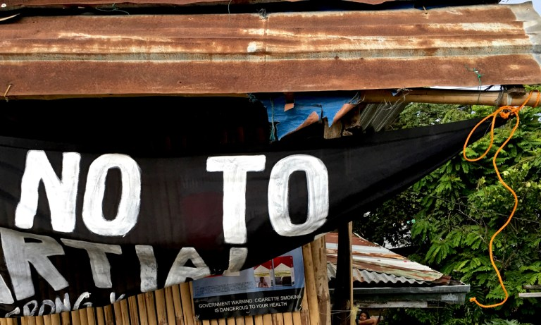banner in the Philippines protesting martial law