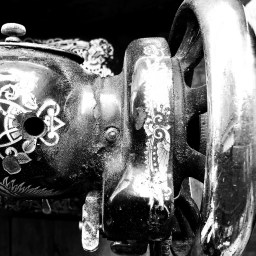 black and white photo of an old singer sewing machine