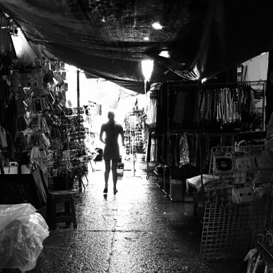 black and white silhouette of a girl walking