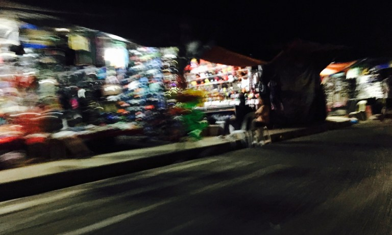 slow exposure shot of fiesta stalls at night