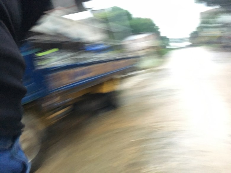 blurred street shot of mud and a truck
