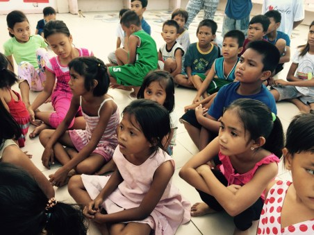 the children listen to a poem by Dr June Perkins