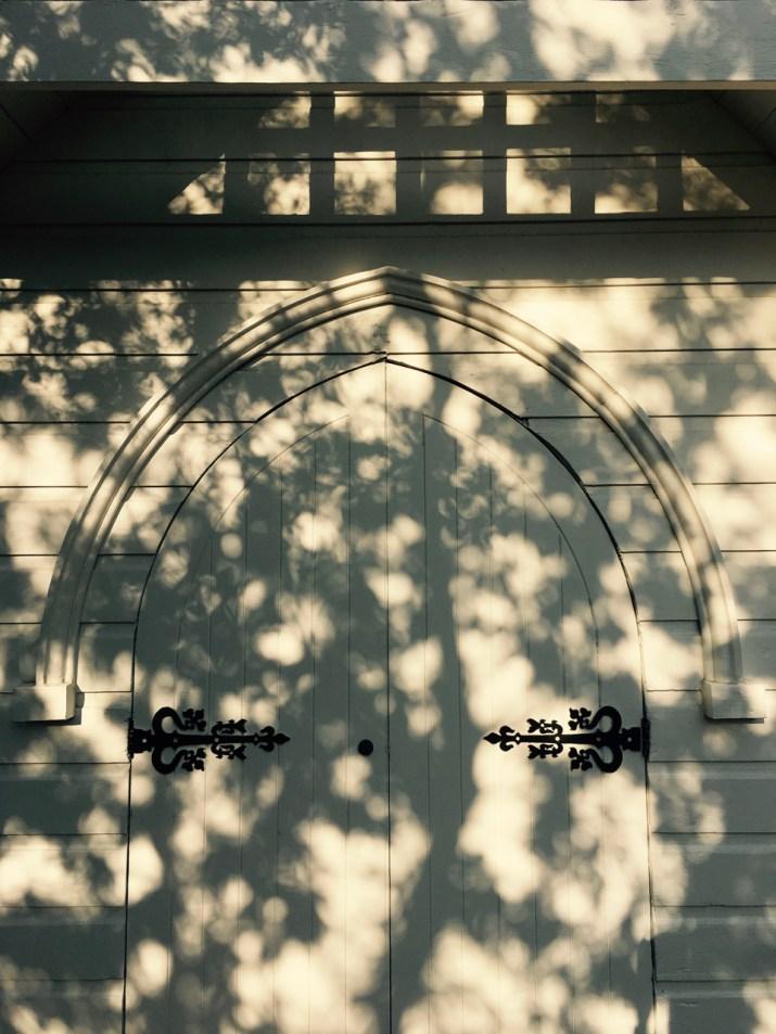 shadows on a church door