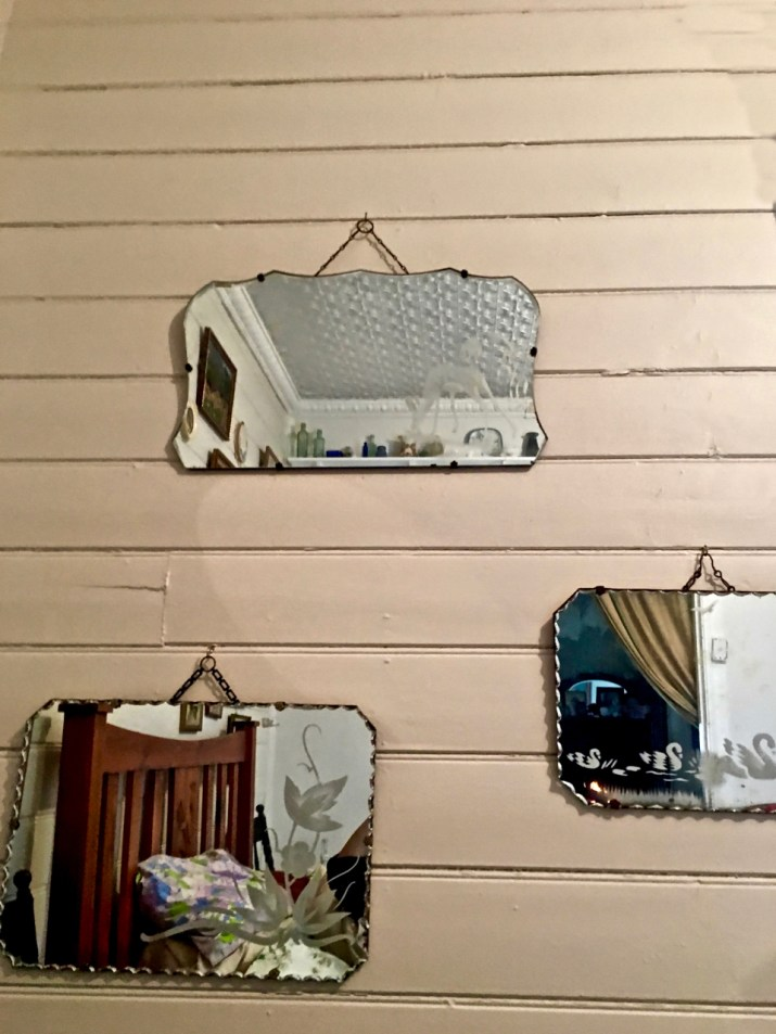 old mirrors on a timber wall