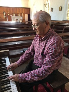 uncle richard playing the organ in hartley church