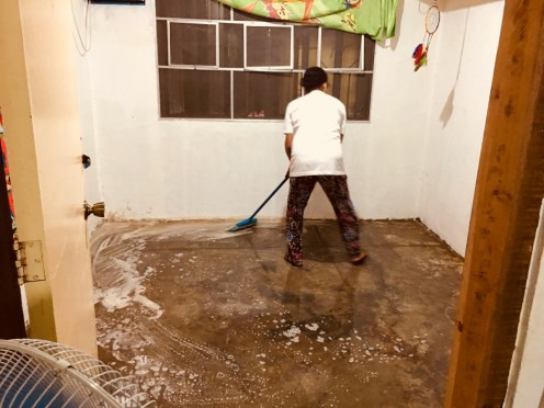 scrubbing the house at it flooded yet again.