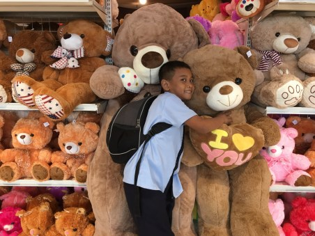 school boy with teddy bears