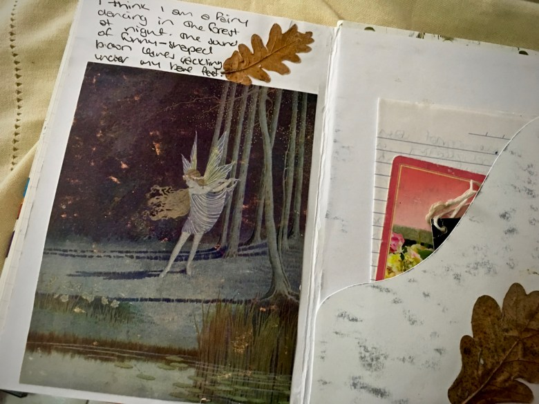 old painting of a fairy pasted into a journal