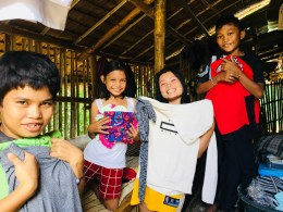 Filipino kids showing their new clothes