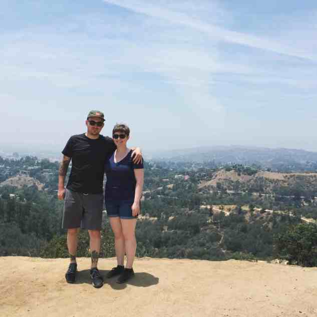 melissa and julian standing in front of california hills