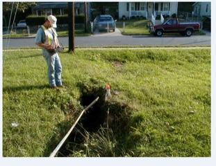 Photo of drainage pipe and ditch before grate installed