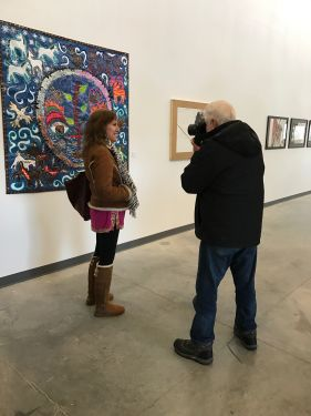 "Lawrence Manning photographing Melissa ""Sasi"" Chambers at Black Elk exhibition"