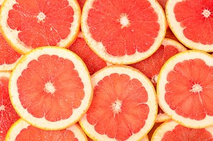 Fresh grapefruit as a background