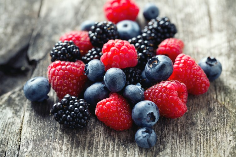 summer berries on wooden surface