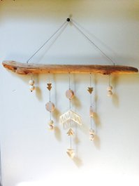 Geomentric Brass and wood hanging by Sarah Perez.