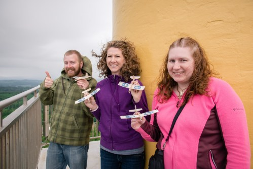 Devin, Melanie and Erin getting ready to fly wooden airplanes off the Astoria Column