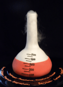 Chemistry flask cake with dry ice