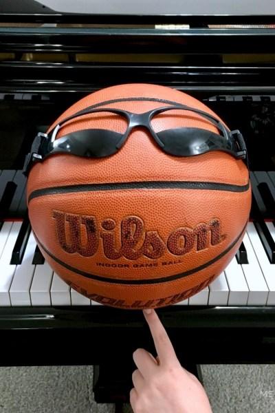 Basketball sitting on piano keys