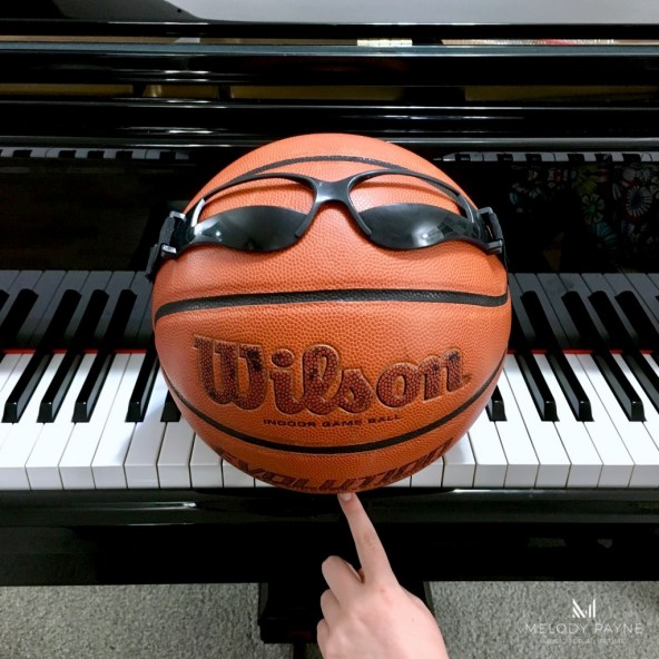 Basketball sitting on piano keys