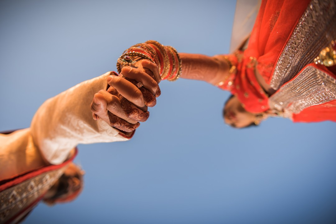 La Torretta Indian Wedding Photography Lake COnroe Melonhead Photo Hands from below big sky