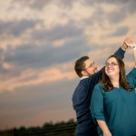 dancing on top of a parking garage for engagement pictures