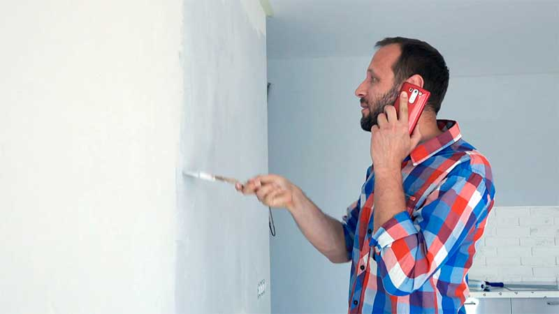 Commercial Painters Making Phone Gesture. Call Me Back Sign