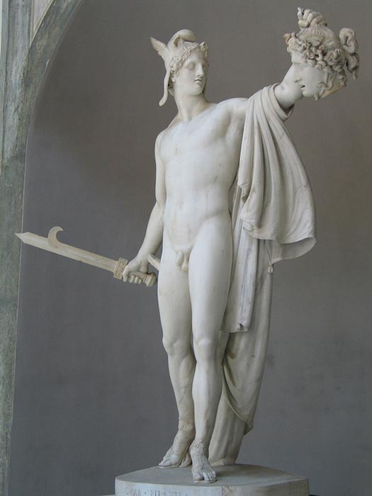 Perseus with head of Medusa. The stone hero stands frozen in time.