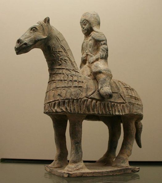 A Chinese terracotta figurine of a cataphract horse and rider. (386–534 CE)
