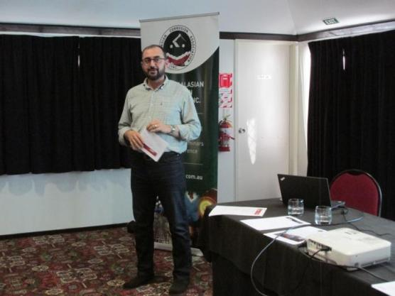 The picture shows Raed giving the Branch President's report for the year at the AGM