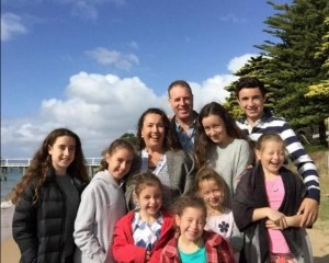 A photograph of Katie, Dave and their 8 children