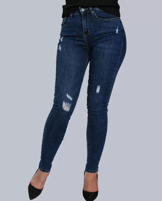 blauwe spijker broek met scheurtjes