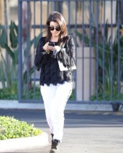 kourtney-kardashian-business-meeting-ann-taylor-feathered-fringe-blouse-kardashian-kollection-jeans-timberland-boots