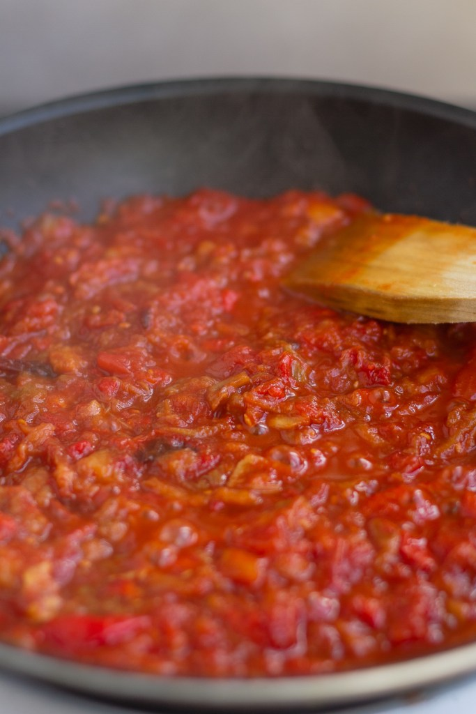 frying aubergine, tomato and rep pepper mix to thicken and reduce