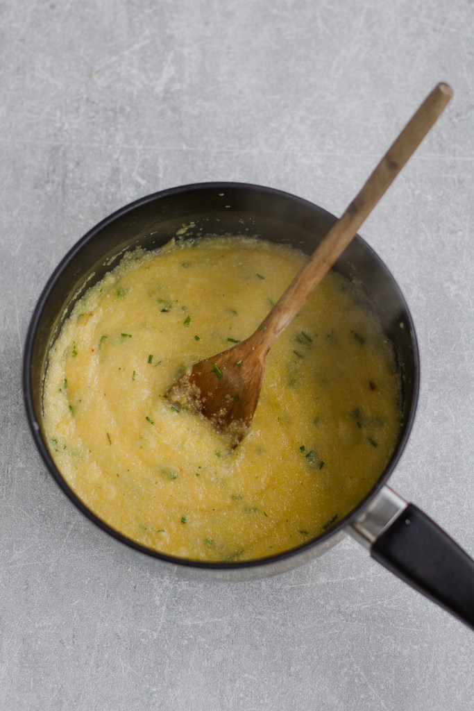herby cauliflower cheese polenta in a small pan