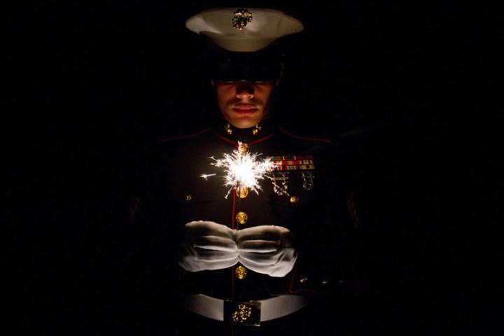 Marine-holding-a-sparkler-celebrating-July-4th