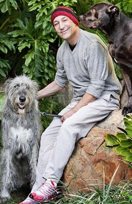 Animal lover ... Sam Simon, pictured with his two dogs, is battling terminal colon cancer. Picture: Twitter