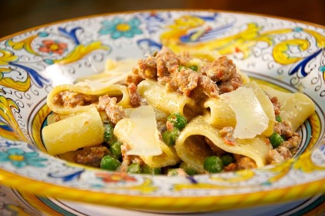 Calamarata pasta with sausage, peas and ricotta cheese
