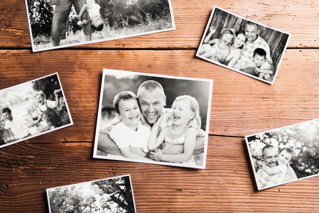 graphicstock-fathers-day-composition-various-black-and-white-family-pictures-studio-shot-on-wooden-background_H_eiS_8BGZ.jpg