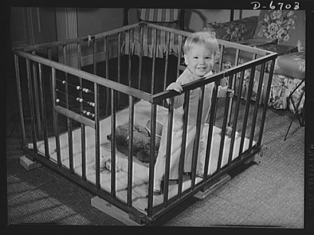 Health measures for low home temperatures. Although your government recommends that homes be kept at sixty-five degrees temperature this winter, the rooms in which infants and children up to three years play can be kept at seventy degrees. But if your toddler plays in other parts of the house, dress him warmly and put his playpen on blocks to avoid floor drafts.  1942 October.  Albert Freeman, photographer (Library of Congress)