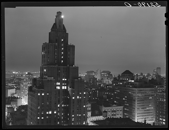 A rainy evening in New York City looking west toward Hudson River from University Place.  September 1939.  Marion Post Wolcott, photographer.