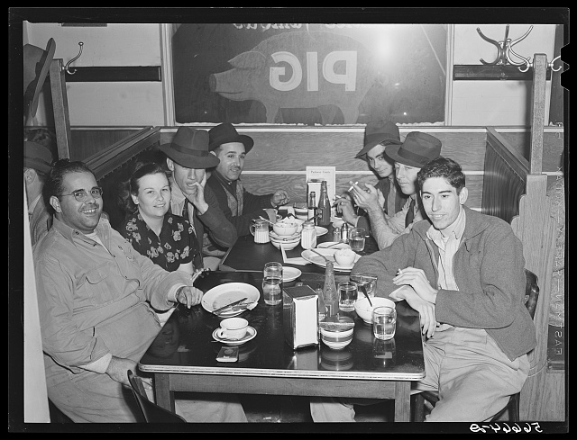 Construction workers eating in cafe in Alexandria, they say food is up at least one-third. Often prices are doubled for meals.  1940 December.  (Photo: Marion Post Wolcott)